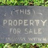 Painted THIS PROPERTY FOR SALE Sign