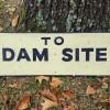 DAM SITE Sign